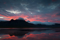 A summer night at Snæfellsnes Peninsula, pink clouds above the mountains.