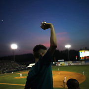 A fan with a fly ball  during the New Britain Rock Cats Vs Binghamton Mets Minor League Baseball game at New Britain Stadium, New Britain, Connecticut, USA. 2nd July 2014. Photo Tim Clayton