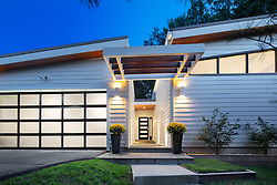 3553 Nellie Curtis Modern Home Exterior twilight with glass garage door VA 2-174-303
