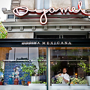 Ceviche chef Jason Hull prepares a dish in the window of Oyamel, a Mexican restaurant  in downtown Washington, DC.