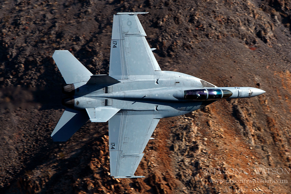 United States Navy Boeing F/A-18F Super Hornet (NJ 174) from the VFA-122 Flying Eagles squadron, Naval Air Station Lemoore, flies low level on the Jedi Transition through Star Wars Canyon / Rainbow Canyon, Death Valley National Park, Panamint Springs, California, United States of America