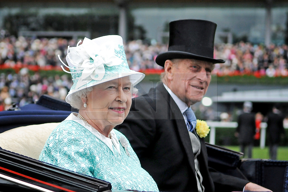 19/06/2009 Ladies Day at Royal Ascot 2009 HRH Queen Elizabeth II and Prince Phillip arrive at the Parade Circle in an open top carriage