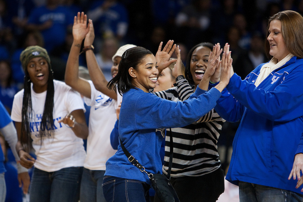 During halftime former UK women's Basketball standout Keyla Snowden high fives former teammates as she and other women in sports were honored during the 40 Years of Title IX program. The University of Kentucky Women's Basketball team hosted Georgia, Sunday, Feb. 03, 2013 at Memorial Coliseum in Lexington.