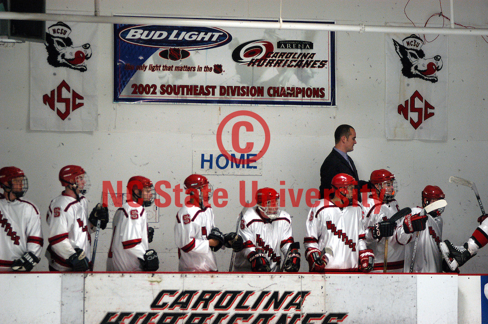 NC State hockey club players watch the action during a game against Appalachian State University.     PHOTO BY ROGER WINSTEAD