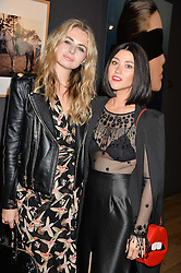 Left to right, LAURA COLEMAN and CAT CAVELLI friend of Jude Law at a private view of photographs in aid of the Sir Hubert von Herkomer Arts Foundation held at Alon Fine Art, 5-7 Dover Street, London on 8th September 2015.