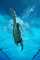 Male swimmer in pool, underwater view