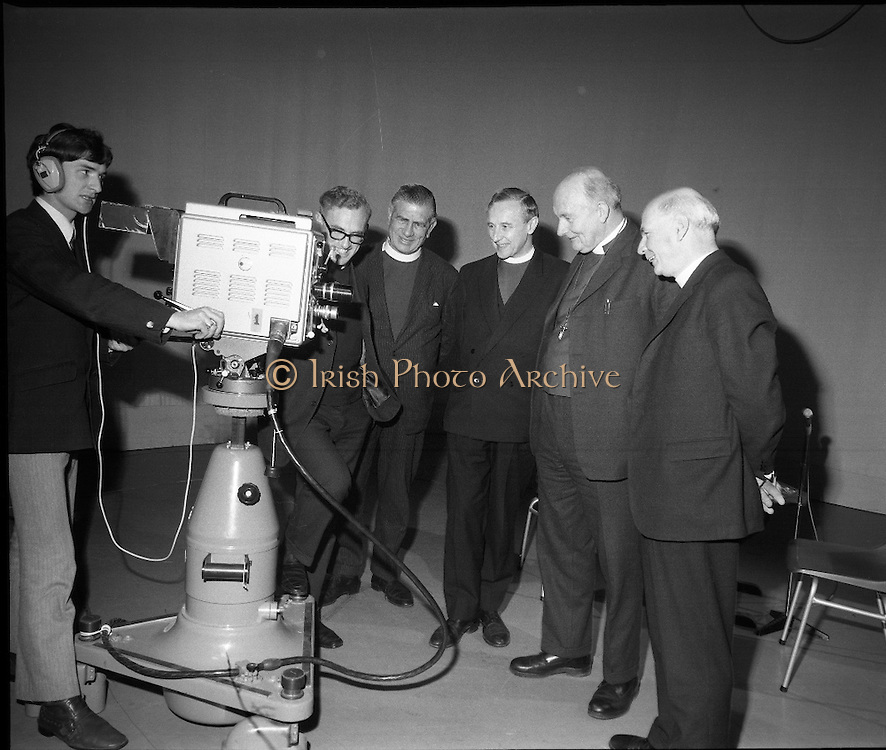 Church of Ireland Course for Bishops at Communication Centre.<br /> 1970.<br /> 28.05.1970.<br /> 05.28.1970.<br /> 28th May 1970.<br /> A two day coures in communications was held for Church of Ireland  Bishops at The Communication Centre.Booterstown Ave, Blackrock, Dublin. The course was designed so that the Bishops would be able to give their message in a clear and concise way using radio and television.<br /> <br /> Image shows Mr Tom Flanagan going through the operation of the camera for the Bishops who attended the communications course.