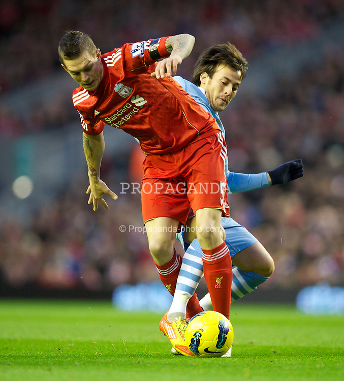 LIVERPOOL, ENGLAND - Sunday, November 27, 2011: Liverpool's Daniel Agger in action against Manchester City's David Silva during the Premiership match at Anfield. (Pic by David Rawcliffe/Propaganda)