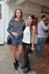 Left to right, SABRINA PERCY and LEXI ABRAMS at the launch of Dundas London held at Fiskins Classic Car Showroom, 14 Queens Gate Place Mews, London on 25th June 2014.