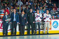 REGINA, SK - MAY 23: Jason Bernard of Sherwin-Williams, Angel Taypotat of the Royal Canadian Legion Branch 001, Commanding Officer, Lieutenant Jay MacKeen of the PPCLI 2nd Battalion and Kurt and Claude Wickenheiser on behalf of brother Dale Wickenheiser await the ceremonial puck drop at the Brandt Centre on May 23, 2018 in Regina, Canada. (Photo by Marissa Baecker/CHL Images)