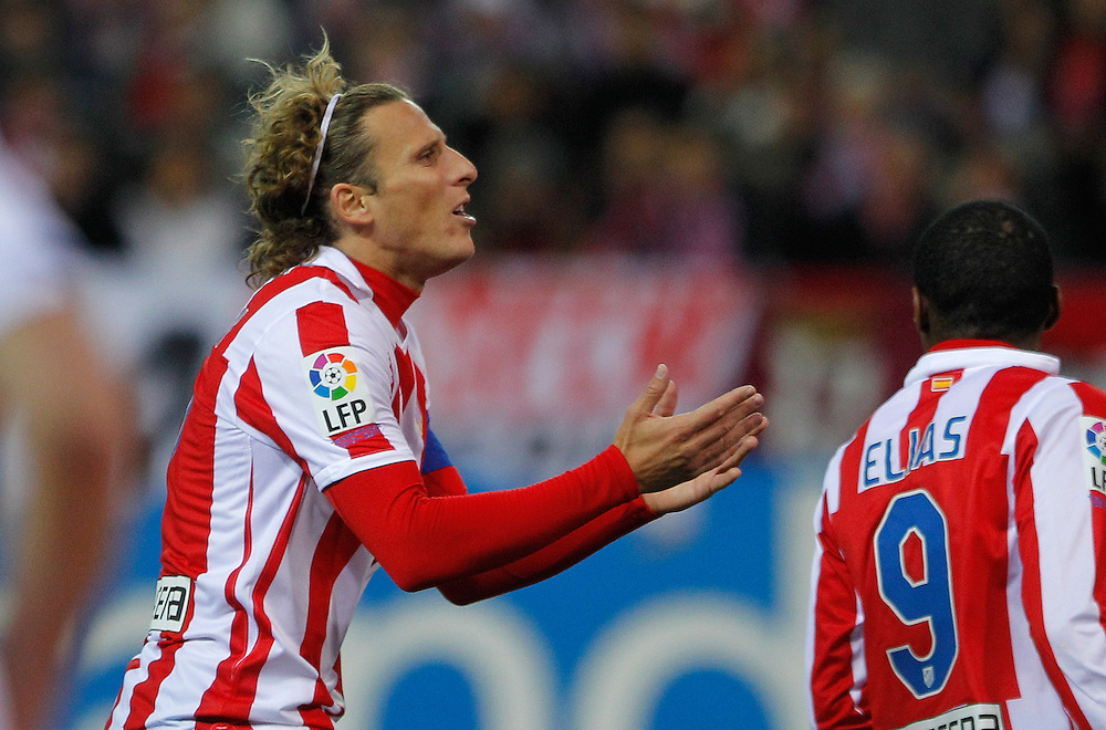Atletico de Madrid's Diego Forlan from Uruguay, reacts during his Spanish Copa del Rey soccer match against Real Madrid at the Vicente Calderon stadium in Madrid, Thursday, Jan. 20, 2011.