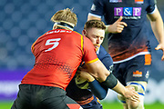 George Taylor (#13) of Edinburgh Rugby takes a hit from John-Charles Astle (#5) of Isuzu Southern Kings during the Guinness Pro 14 2018_19 rugby match between Edinburgh Rugby and Isuzu Southern Kings at the BT Murrayfield Stadium, Edinburgh, Scotland on 5 January 2019.