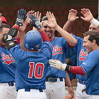 03 June 2010: Daniel Sanchez of C.B. Sant Boi is congratulated by his teammates after his solo home run during the 2010 Baseball European Cup match won  8-4 by C.B. Sant Boi over the Rouen Huskies, at the Kravi Hora ballpark, in Brno, Czech Republic.