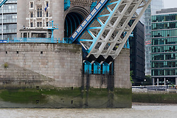 © Licensed to London News Pictures. 29/09/2016. LONDON, UK.  Detail of Tower Bridge bascules seen raised this morning as they lift to allow the Dutch heritage tug, MV Holland to pass underneath. 122 year old Tower Bridge will close entirely to traffic for three months from 1 October and will include major maintenance to the bridge lifting mechanisms. During this time, the bascules, which are raised 800-900 times per year will be maintained as operable to river traffic. As well as large ships, Tower Bridge regularly opens to allow vessels with tall masts to pass under, such heritage tug, MV Holland who passed underneath this morning.  Photo credit: Vickie Flores/LNP