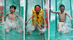 May 29, 2017 - Nantong, China - 3 picture combo showing children playing at an aquatic park in Nantong, east China's Jiangsu Province, to greet the upcoming International Children's Day.  (Credit Image: © Xu Peiqin/Xinhua via ZUMA Wire)