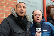 Ex-Forest player Stan Collymore is interviewed by BBC Radio Nottingham's Robin Chipperfield during a peaceful demonstration to show their frustration against Forest chairman Fawaz Al-Hasawi ahead of the EFL Sky Bet Championship match between Nottingham Forest and Bristol City at the City Ground, Nottingham, England on 21 January 2017. Photo by Jon Hobley.