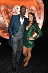 OZWALD BOATENG and LOUISE HAZEL at the Warner Music Group & Ciroc Vodka Brit Awards After Party held at The Freemason's Hall, 60 Great Queen St, London on 24th February 2016.