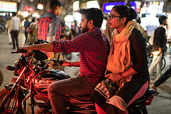 May 18, 2019 - Varanasi, India - On 17 May 2019, an Indian male and female ride a motorcycle in the evening traffic of Varanasi, India. (Credit Image: © Diego Cupolo/NurPhoto via ZUMA Press)