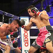 Jonathan Lecona (L) fights Melvin Lopez during a Telemundo boxing match at Osceola Heritage Park on Friday, July 20, 2018 in Kissimmee, Florida.  (Alex Menendez via AP)