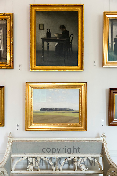 Paintings by 19th Century artist Vilhelm Hammershoi in gallery at Ordrupgaard Art Museum near Copenhagen in Denmark