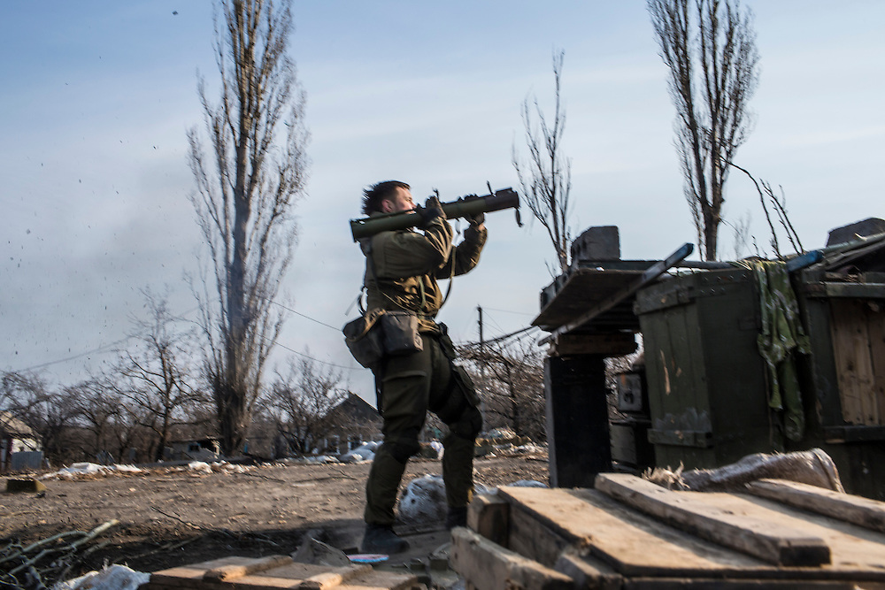PISKY, UKRAINE - MARCH 20, 2015: A fighter for the Dnipro-1 battalion, a pro-Ukrainian militia, fires a shoulder-launched anti-tank rocket toward pro-Russian rebel positions in Pisky, Ukraine. CREDIT: Brendan Hoffman for The New York Times