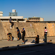 Brooklyn boys skate along development of future Atlantic Yards project in the Prospect Heights neighborhood of Brooklyn near Vanderbilt Avenue in Brooklyn New York