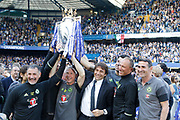 Chelsea Manager Antonio Conte and his team of trainers celebrate with the trophy during the Premier League match between Chelsea and Sunderland at Stamford Bridge, London, England on 21 May 2017. Photo by Andy Walter.