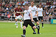 Sheffield United midfielder John Fleck (4) on defensive duties during the Pre-Season Friendly match between Northampton Town and Sheffield United at the PTS Academy Stadium, Northampton, England on 20 July 2019.