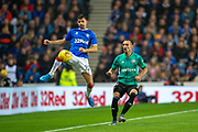 Jordan Jones (#22) of Rangers FC jumps to get the ball ahead of Marko Vesovic (#29) of Legia Warsaw during the Europa League Play Off leg 2 of 2 match between Rangers FC and Legia Warsaw at Ibrox Stadium, Glasgow, Scotland on 29 August 2019.