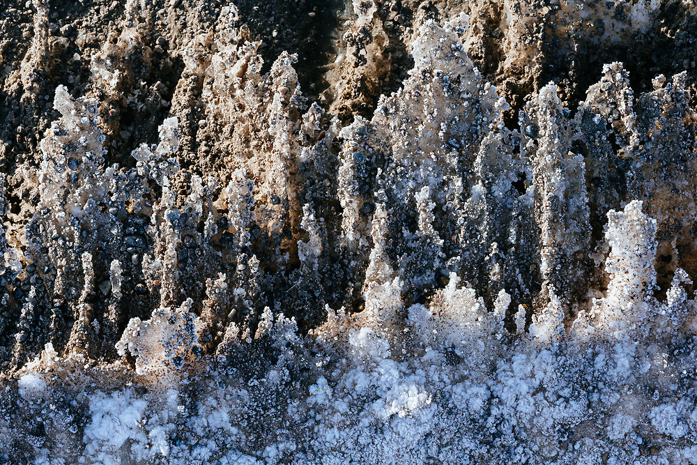 The shapes and textures of snow crystals along a roadside in Grand Teton National Park, Wyoming.