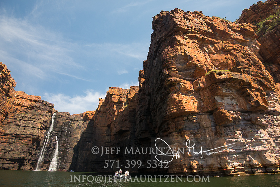 Expedition travelers aboard zodiac inflatable boats explore King George River and waterfalls in the Kimberley Region of Western Australia.