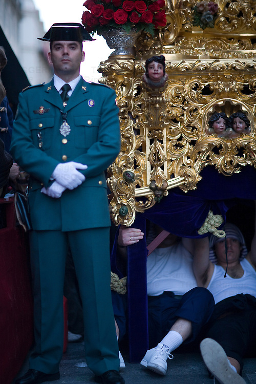 Civil Guard escorting a float and float bearers on a break, Holy Week 2008, Seville, Spain