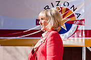 14 FEBRUARY 2011 - PHOENIX, AZ:  Arizona Governor JAN BREWER says the Pledge of Allegiance during statehood day observances at the State Capitol in Phoenix Monday. Arizona became the 48th state in the United States on Feb. 14, 1912. Gov. Brewer announced that the state is planning a series of centennial events leading up to Feb 14, 2012 for the coming year during her speech at the state capitol Monday morning.    Photo by Jack Kurtz