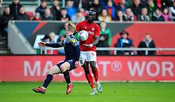 Famara Diedhiou of Bristol City tries to get past Ben Williams of Barnsley-Mandatory by-line: Nizaam Jones/JMP - 18/01/2020 - FOOTBALL - Ashton Gate - Bristol, England - Bristol City v Barnsley - Sky Bet Championship
