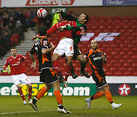 Photo: Richard Lane/Richard Lane Photography. Nottingham Forest v Blackpool. Coca Cola Championship. 13/12/2008. Keeper Paul Rachubka punches in front of Nathan Tyson