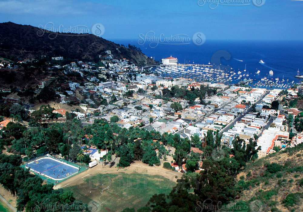 October 3, 1998:  Arial photograph of an exotic in-line hockey rink one mile from shore on the island of Catalina in the Pacific Ocean off the state of California.  60'x185' outdoor roller hockey rink was built by former NHL Boston Bruins equipment manager Ray Scott Logan. This rink is placed less than a mile off the coastline of the beach where tourists and locals sunbathe and go boating. Placed next to a golf course and soccer field. .