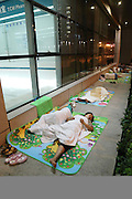 ZHENGZHOU, CHINA - (CHINA OUT) <br /> <br /> A Visit To The First Affiliated Hospital Of Zhengzhou University<br /> <br /> Relatives of patients have a rest outside The First Affiliated Hospital of Zhengzhou University on July 3, 2015 in Zhengzhou, Henan Province of China. According to the offical data, The First Affiliated Hospital of Zhengzhou University has more than 7,000 beds, and more than 310,000 patients were hospitalized in the hospital last year, with the income of 7.5 billion yuan (1.2 billion USD).  <br /> ©Exclusivepix Media