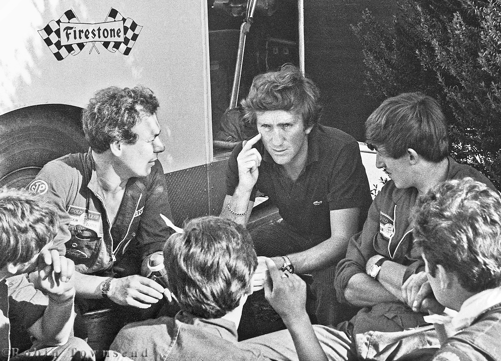 Austrian Lotus driver, Jochen Rindt, chats with mechanics, during the 1969 Spanish Grand Prix at the Montjuïc urban circuit in Barcelona, Spain.
