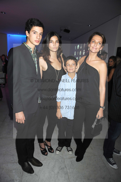 Left to right,  MILO ASTAIRE, LILY ALDRIDGE, FINN CONSTANTINE and SAFFRON ALDRIDGE at an exhibition of work by Alan Aldridge held at the Design Museum, Shad Thames, London on 13th October 2008.