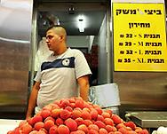 Vendor in the Mahane Yehuda Market Jerusalem Israel 2013.