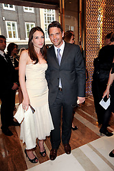 DOUGRAY SCOTT and his wife Claire Forlani (check) at a party to celebrate the opening of the Louis Vuitton Bond Street Maison, New Bond Street, London on 25th May 2010.