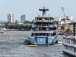 © Licensed to London News Pictures. 01/07/2018. London, UK.  Billionaire Spurs owner, Joe Lewis's latest state of the art superyacht, Aviva arrives in London today and moors at Butlers Wharf near Tower Bridge on the River Thames. The 321 feet long multi-million pound mega yacht, Aviva – the owner's fourth yacht to bear the same name, Aviva, was built in strict secrecy at a yard in Germany. Aviva is believed to feature a full-size tennis court and can accommodate up to 16 guests. London born businessman, Joe Lewis who owns Tottenham Hotspur Football Club, 80 is worth an estimated £4bn and now lives in the Bahamas. Photo credit: Graham Long /LNP