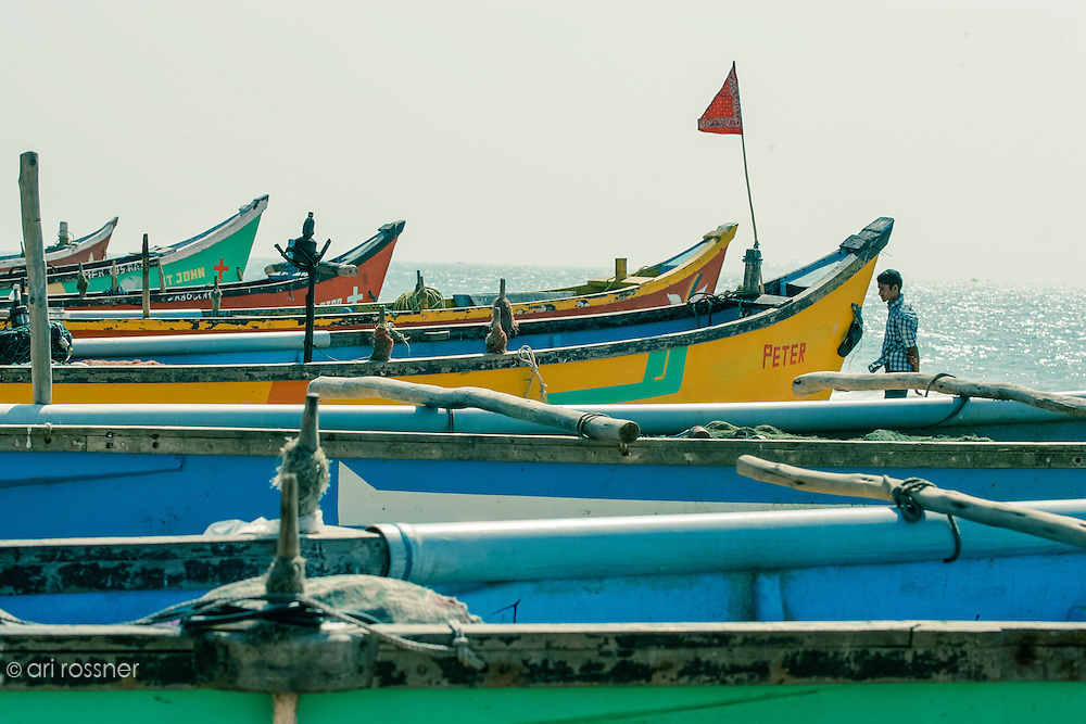 Colorful barques moored on the beach.