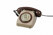 Old style dial telephone on white background