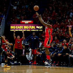 May 6, 2018; New Orleans, LA, USA; New Orleans Pelicans guard Jrue Holiday (11) shoots a three point basket as Golden State Warriors forward Kevin Durant (35) defends during the second quarter in game four of the second round of the 2018 NBA Playoffs at the Smoothie King Center. Mandatory Credit: Derick E. Hingle-USA TODAY Sports
