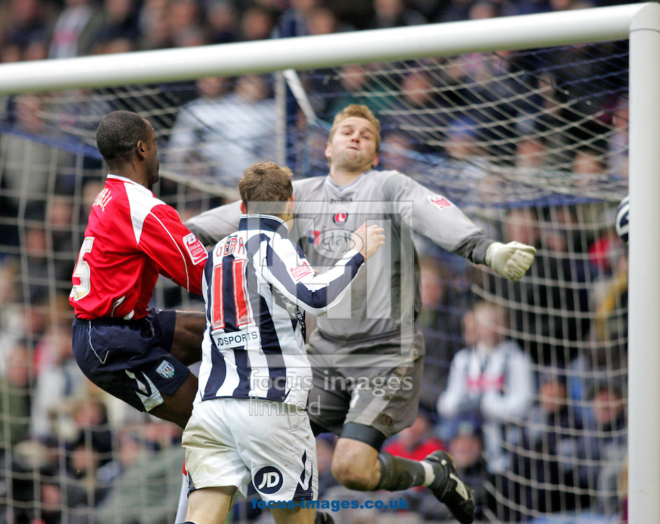West Bromwich - Saturday, December 15th, 2007: Zoltan Gera of West Brom scores during the second half despite the efforts of Chris Powell (L) and Nicky Weaver (R) of Charlton Athletic during the Coca Cola Championship match at The Hawthorns, West Brom. (Pic by Paul Hollands/Focus Images)