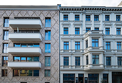 Contrast between modern apartment building and traditional building in gentrified district of Prenzlauer Berg, Berlin, Germany