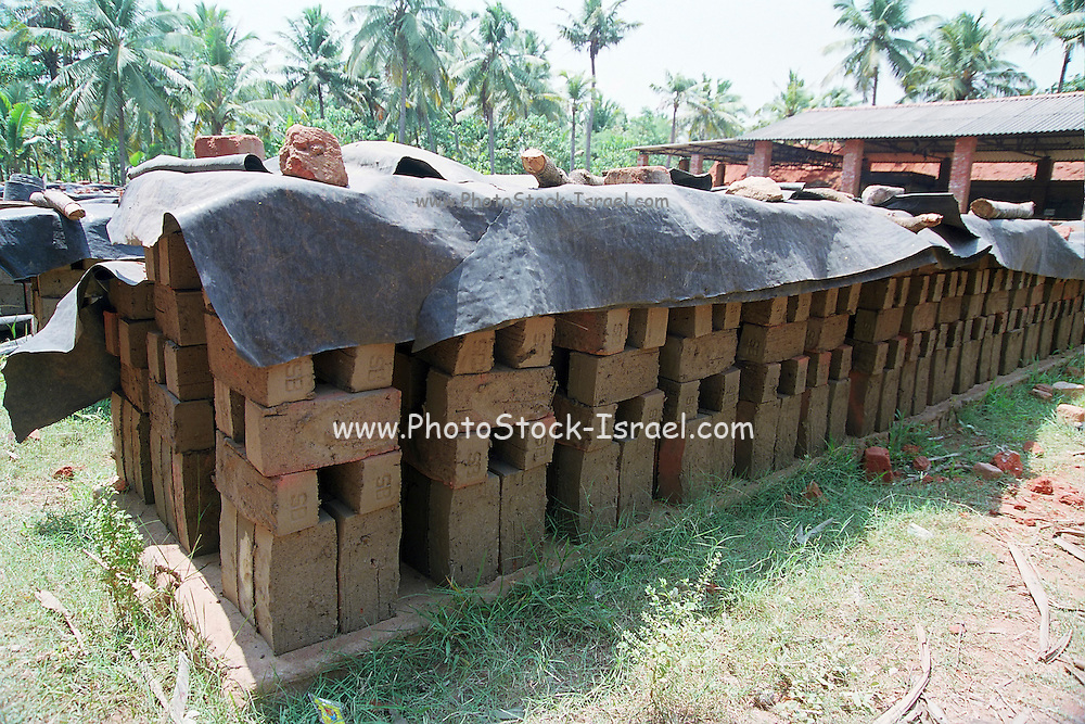 clay Bricks left out to dry at a brick production site India, Kerala, a state on the tropical coast of south west India