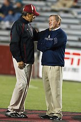 October 2, 2010; Chestnut Hill, MA, USA;  Boston College Eagles head coach Frank Spaziani (left) talks with Notre Dame Fighting Irish head coach Brian Kelly (right) before the game at the Alumni Stadium.