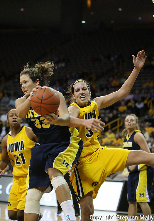 26 JANUARY 2009: Michigan guard/forward Carmen Reynolds (33) and Iowa forward Wendy Ausdemore (32) battle for a rebound during the first half of an NCAA women's college basketball game Monday, Jan. 26, 2009, at Carver-Hawkeye Arena in Iowa City, Iowa. Iowa defeated Michigan 77-69.